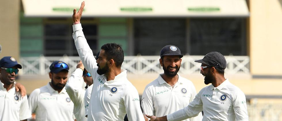 India's captain Virat Kohli (C) waves after winning the fourth day of the third Test cricket match between England and India at Trent Bridge in Nottingham, central England on August 21, 2018