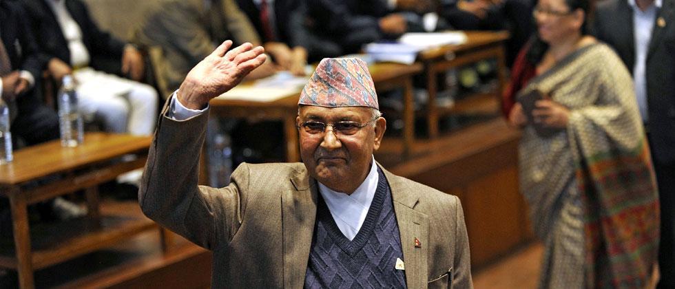 File photo dated October 28, 2015 Nepal's then PM K.P. Sharma Oli waves after casting his vote. Photo-AFP/Prakash Mathema