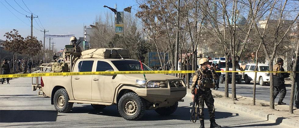 AFP: Afghan security forces stand guard near the site of multiple blasts in Kabul near a media outlet and mosque on December 28