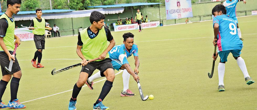 Krida Prabodhini (green) and GST & Customs fight it out in a Pool E encounter in the 7th Late Hussain Hockey Championship, at the Major Dhyan Chand Hockey Stadium
