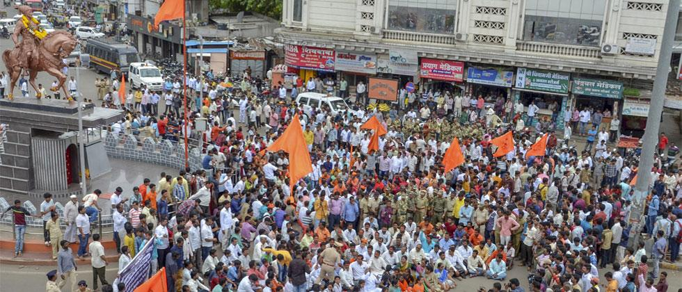 Maratha community members block the road during a protest against the government demanding reservation in Solapur on Saturday, July 21, 2018. PTI Photo
