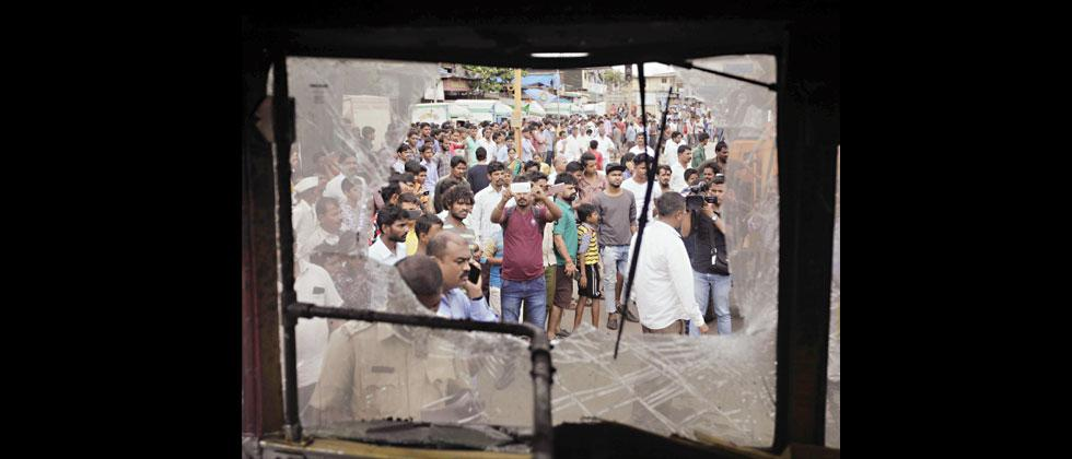 A bus was damaged by the protesters during the State bandh called by Maratha Kranti Morcha in Mumbai on Wednesday. Prashant Sawant/Sakal Times