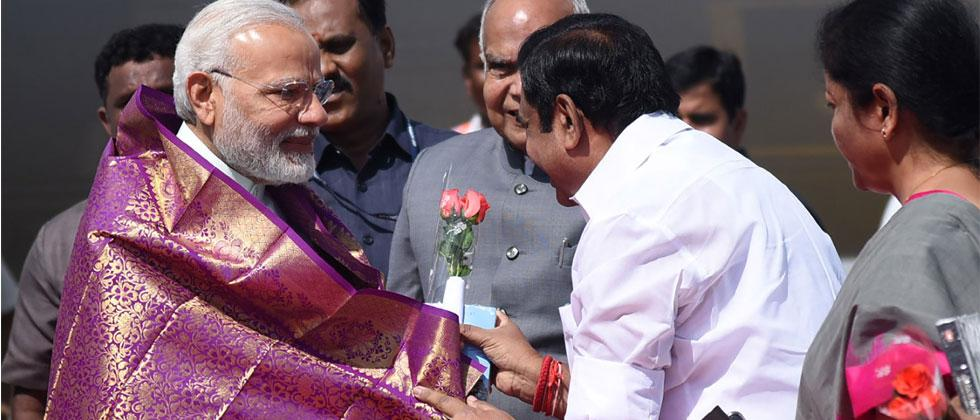 Indian Prime Minister Narendra Modi is welcomed by the Governor of Tamil Nadu Banwarilal Purohit and the Chief Minister of Tamil Nadu Edappadi K. Palaniswami on his arrival in Chennai on April 12, 2018. PIB/AFP
