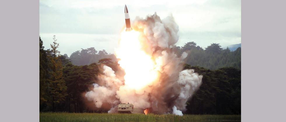 A picture released by North Korea's official Korean Central News Agency (KCNA) shows the test-firing of a new weapon, presumed to be a short-range ballistic missile, at an undisclosed location.