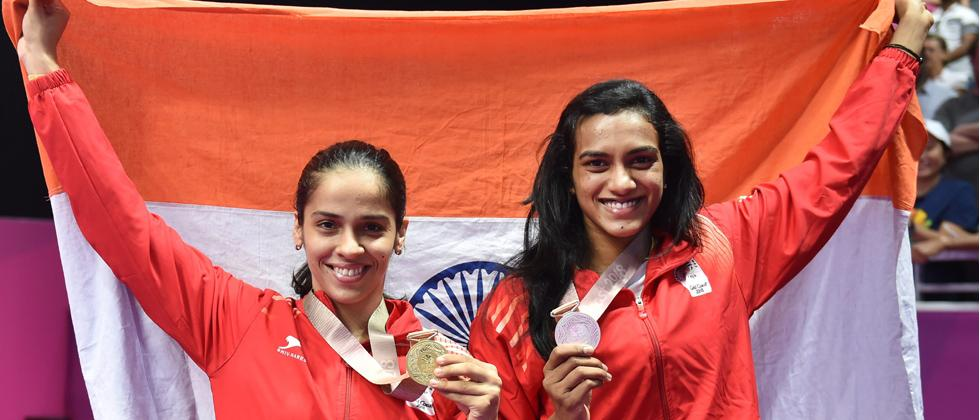 Women's singles gold medalist Saina Nehwal and silver medalist PV Sindhu pose for photographs during the medal ceremony at the Commonwealth Games 2018, in Gold Coast, Australia on Sunday. PTI Photo
