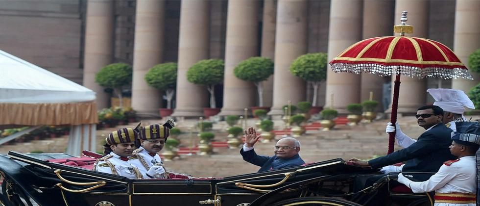 Newly sworn-in President Ram Nath Kovind waves as he leaves in a regal buggy after inspecting a guard of honour in the forecourt of the Rashtrapati Bhavan in New Delhi on Tuesday. PTI Photo