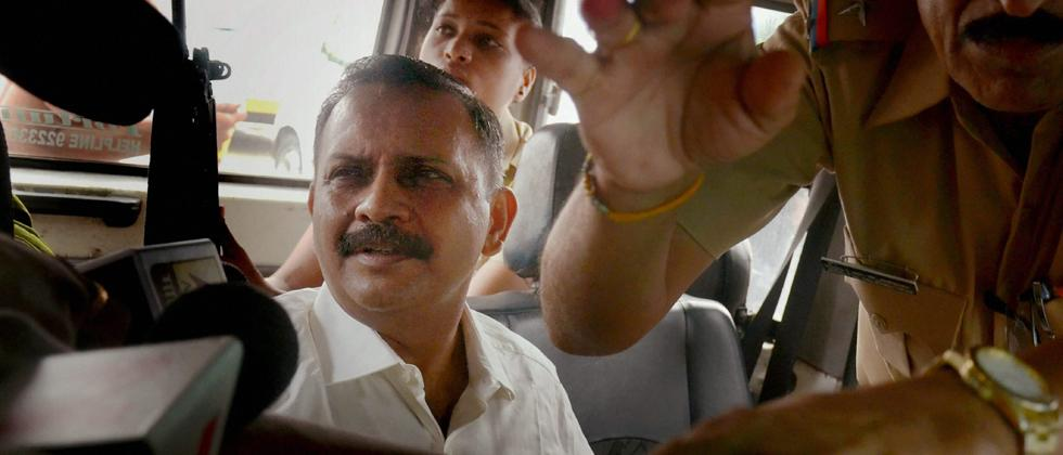 Lt Col Shrikant Prasad Purohit, who was granted bail by the Supreme Court on Monday in the 2008 Malegaon blast case, being taken to the Sessions Court from Taloja Jail in Navi Mumbai on Tuesday