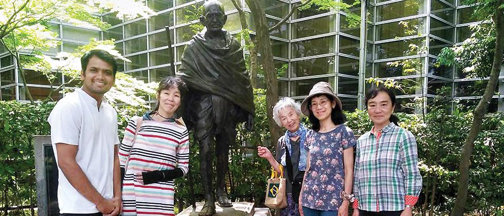 Nitin Sonawane (left) and Japanese citizens stand beside a statue of Mahatma Gandhi. Nitin is currently on the Japanese leg of his 75-nation tour.
