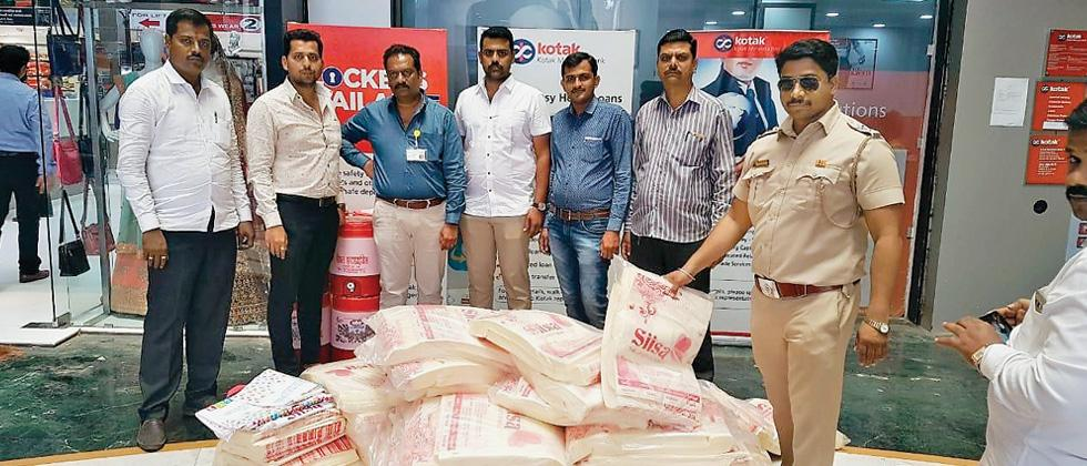Non-woven plastic bags seized from five shops