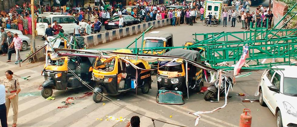 4 dead, 10 hurt as hoarding collapses in city