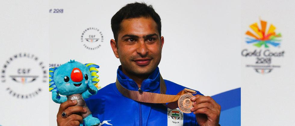 India's bronze medallist Ravi Kumar reacts after competing in the 10m air rifle men's final during the 2018 gold Coast Commonwealth Games. AFP Photo/Patrick Hamilton