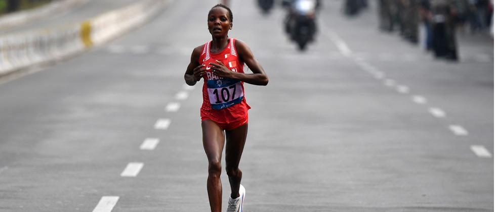 Bahrain's Rose Chelimo runs in the women's marathon athletics event during the 2018 Asian Games in Jakarta