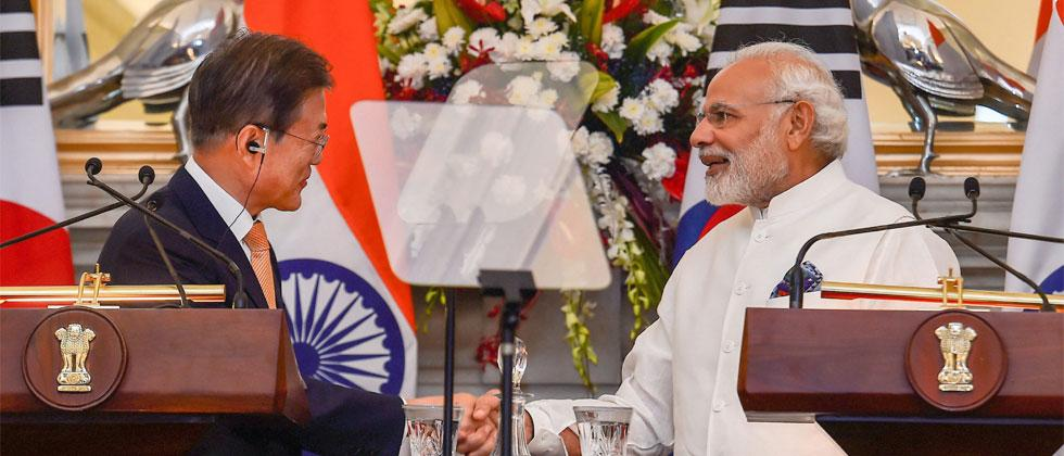 Prime Minister Narendra Modi shakes hands with South Korean President Moon Jae-in after their joint press conference at Hyderabad House, in New Delhi on Tuesday, July 10, 2018. Kamal Singh/PTI