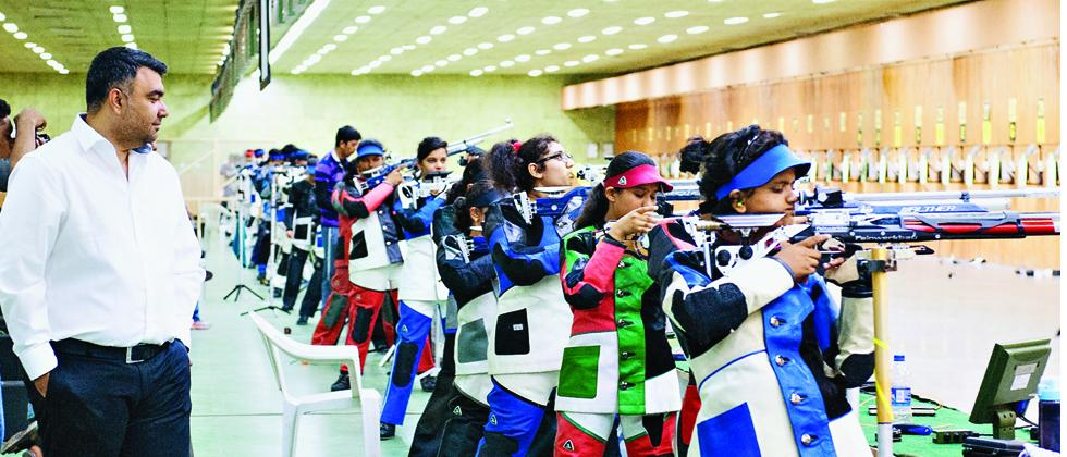 Gagan Narang training kids at the shooting range in Balewadi.
