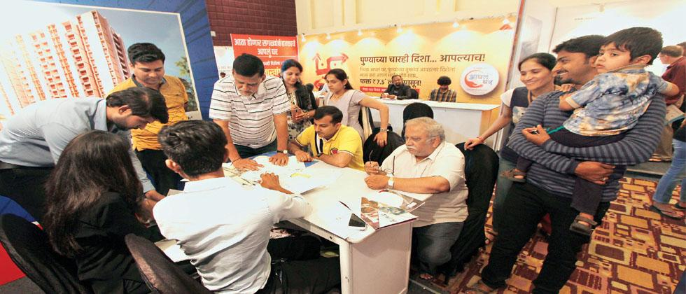 Onlookers flock a stall at Sakal Vastu Expo to know about various properties available in the city on Saturday.