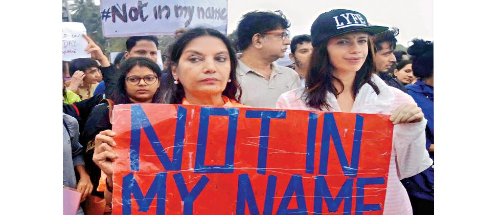 Bollywood actors Shabana Azmi (left) and Kalki Koechlin participate in the silent protest 'Not in My Name' against incidents of targeted lynching, in Mumbai.