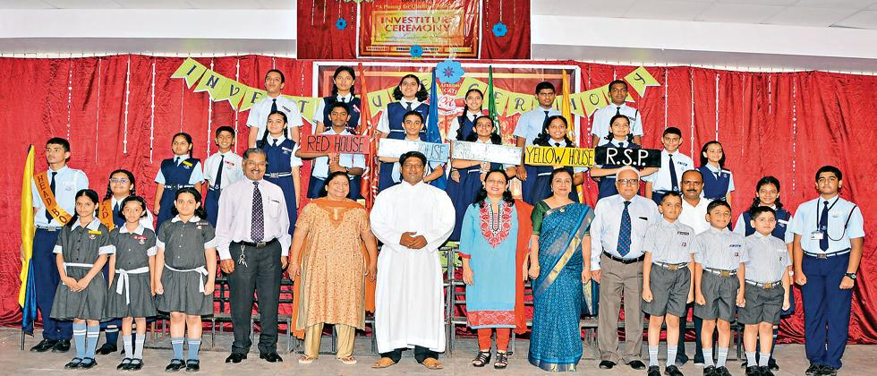 The 26 students from the Aranha's Rosary School pledged at the investiture ceremony.