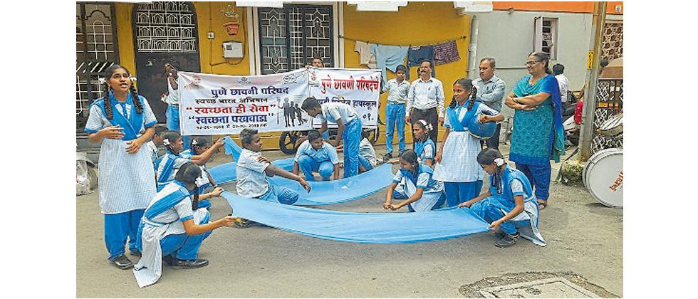 Students of Ghorpadi Village High School perform a street play on cleanliness.