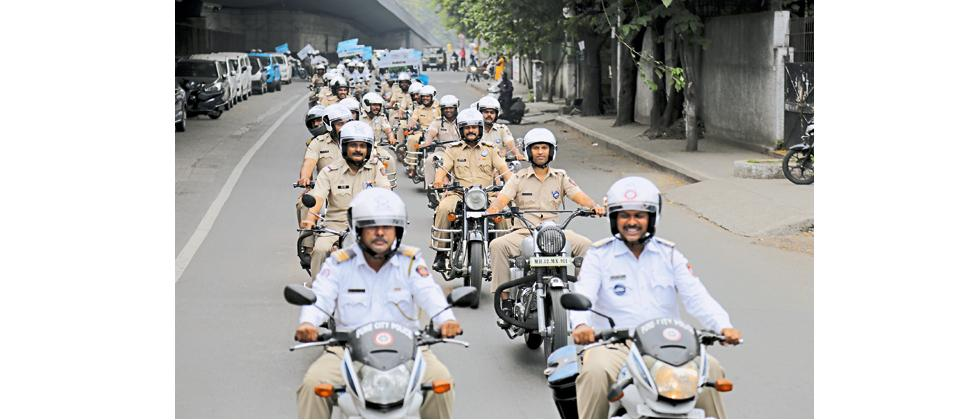 Police personnel riding through Shivajinagar after the launch of Pune city police's 'We Make Pune City Safe' campaign on Tuesday.