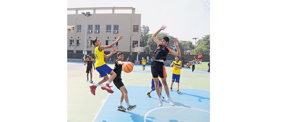 Players of Army Public School, Kirkee (in black) in action against Walnut School, Shivane on Tuesday.