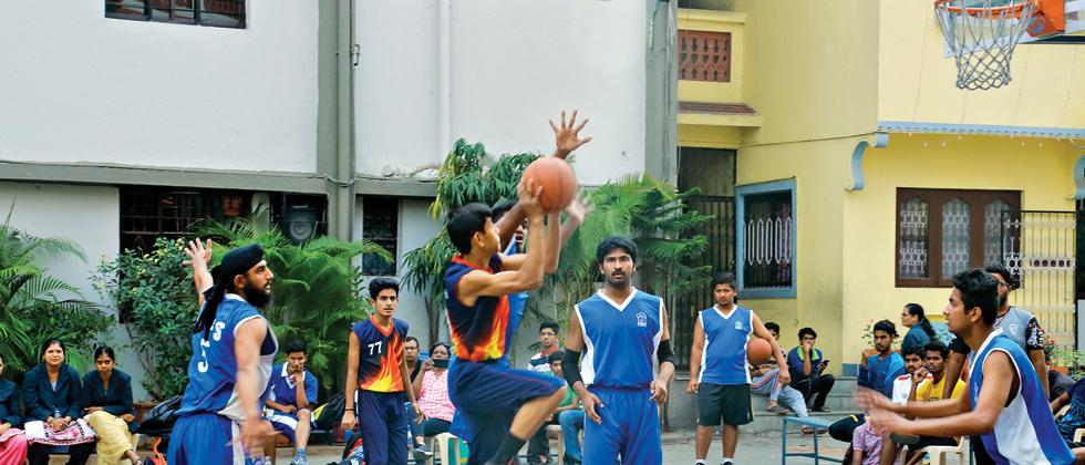 A player from Nirmal Bethany Junior College (black) aims for a basket against Army Public School in the 10th Mar Ivanios Memorial State Level Inter Collegiate Basketball Tournament at Nirmal Bethany Junior College ground on Friday.