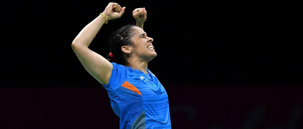 India's Saina Nehwal celebrates her victory over her India's PV Sindhu in their badminton women's single final match at the 2018 Gold Coast Commonwealth Games in Gold Coast on April 15, 2018. Saeed Khan/AFP