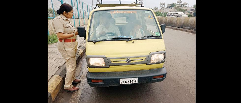 An RTO officer conducts a check on vehicles carring school children. Anand Chaini/Sakal Times