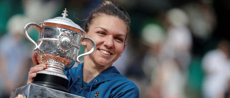 Romania's Simona Halep poses with her trophy, after winning the women's singles final match of The Roland Garros 2018 French Open tennis tournament against Sloane Stephens of the US. Thomas Samson/AFP