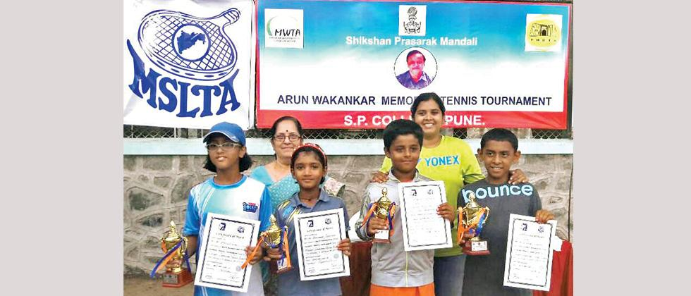All winners and runners up pose with the trophy and certificates at SP College tennis courts on Monday.