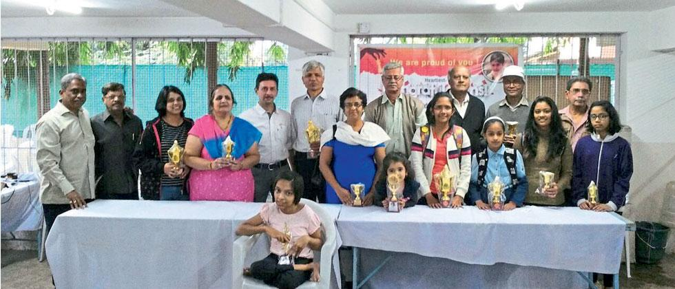 All  winners pose with their trophy after the conclusion of Old Monk One Day Rapid Chess tournament
