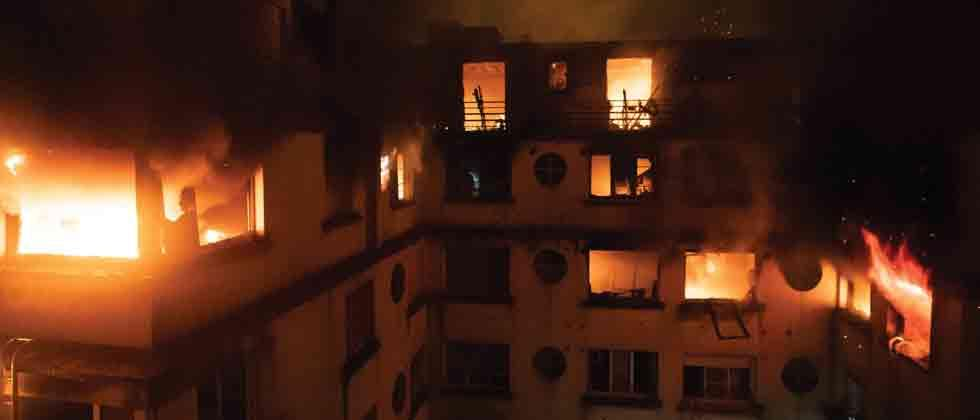 Eight dead in possible arson attack at Paris apartment block