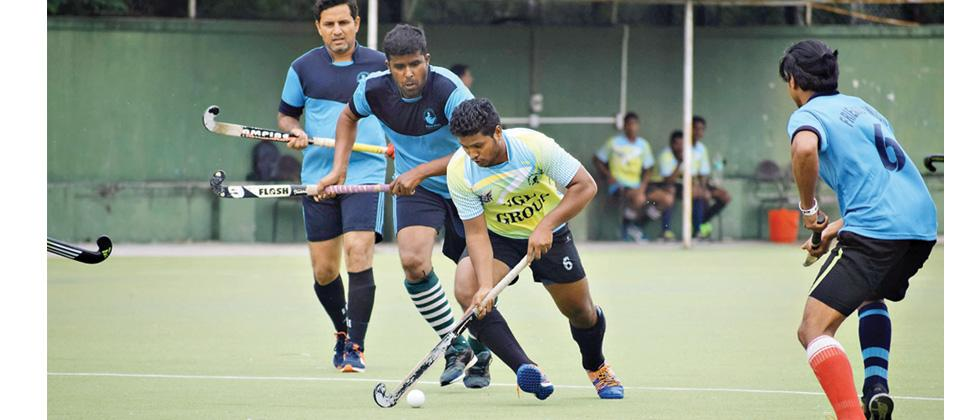 Players of PCMC XI in action against Friends Union (in blue) on Tuesday.