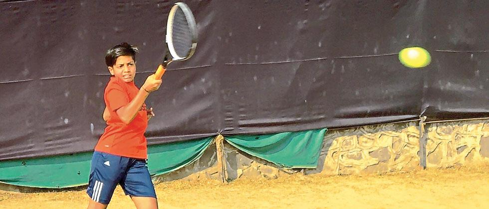Ruma Gaikaiwari in action at Hill Side Gymkhana tennis courts, Bibvewadi