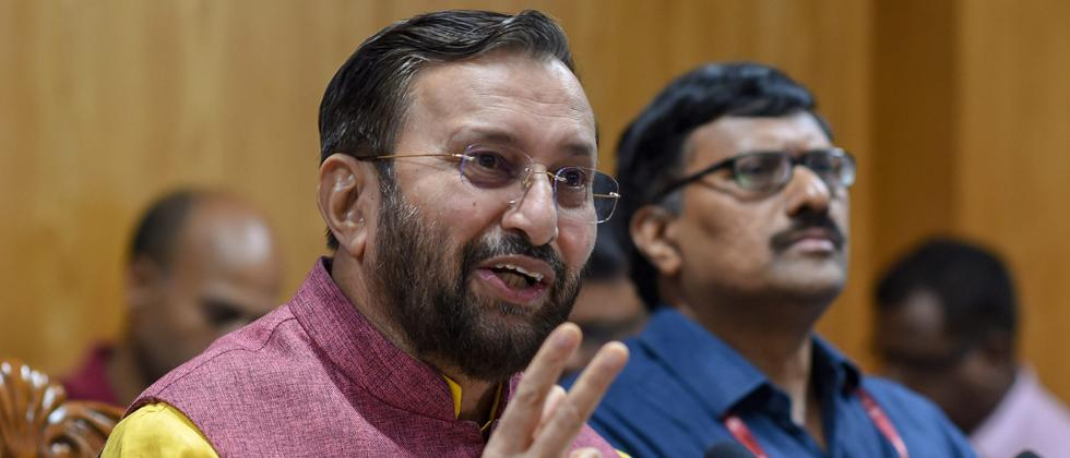 HRD Minister Prakash Javadekar addresses a press conference regarding NEET and JEE examinations, in New Delhi on Saturday.