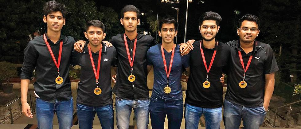 Arya Bhivpathaki captain of VIT (second from left) poses with his team, after winning the badminton tournament at the 13th Inter Engineering, MIT-WPU Sports Meet Summit.