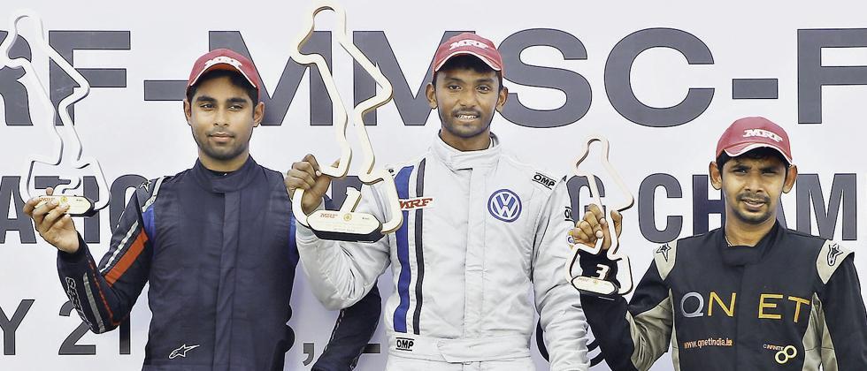 Sandeep Kumar (centre), winner of MRF FF1600 Race 2 flanked by Anindith Reddy (left) and Chetan Korada.