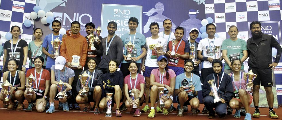 All  winners of NIO Vision run pose with their trophies at the conclusion of the event.