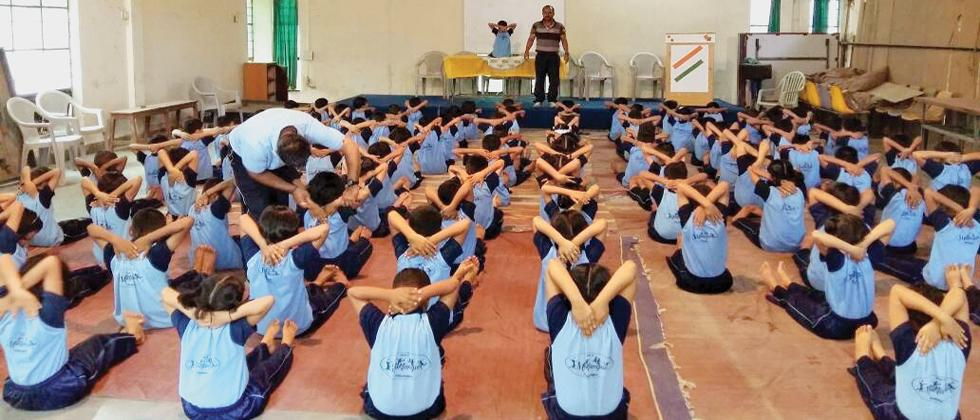 Yogasanas: Students of Muktangan English School celebrate International Yoga Day.