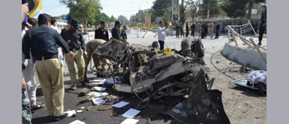 Quetta : Pakistani police officers examine the site of an explosion in Quetta, Pakistan, Friday, June 23, 2017.