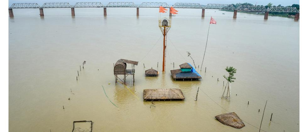A view of submerged huts in flood waters after Ganga River water level rose following monsoon rainfall, in Allahabad on Monday.