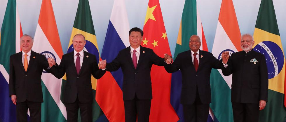 Brazil's President Michel Temer, Russia's President Vladimir Putin, China's President Xi Jinping, South Africa's President Jacob Zuma and India's Prime Minister Narendra Modi pose for a group photo during the BRICS Summit at the Xiamen International Confe