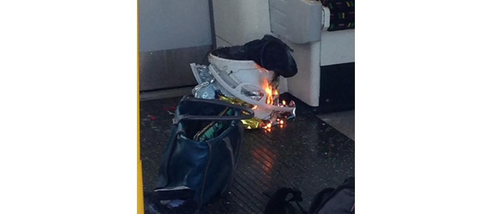 An image taken from a user generated content uploaded on social networks on September 15, 2017, shows a white container burning inside a London Underground tube carriage.