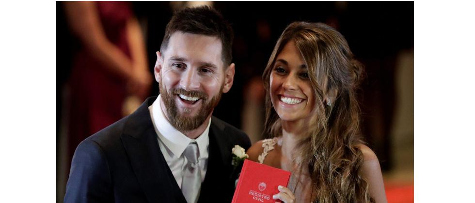 Newlyweds Lionel Messi and Antonella Roccuzzo pose for photographers after tying the knot in Rosario, Argentina on Friday. AP Photo