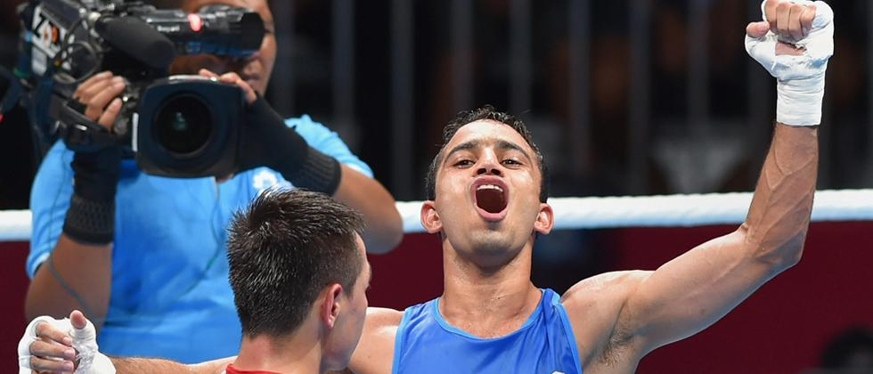 Amit outlasts Olympic champion to strike gold