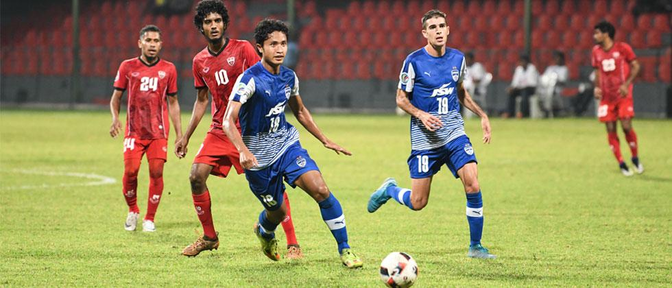 Bengaluru FC striker Thongkhosiem Haokip in action against TC Sports Club, at the National Stadium, in Male
