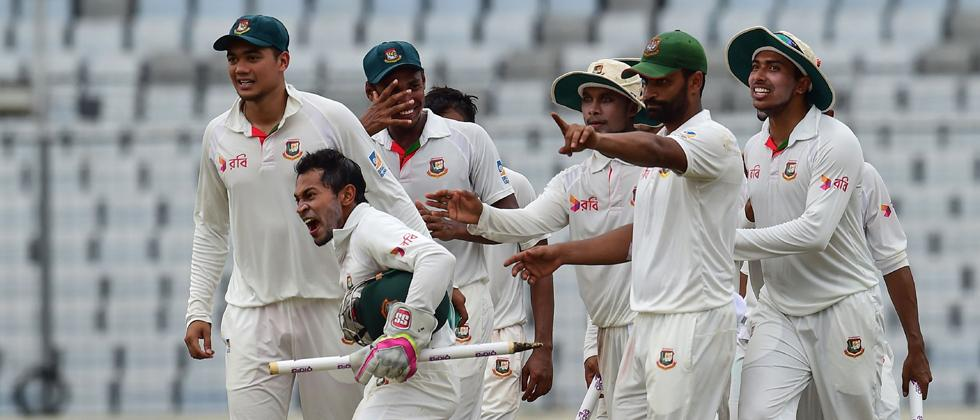 Bangladeshi cricket captain Mushfiqur Rahim (2nd L) celebrates after winning the first Test cricket match between Bangladesh and Australia at the Sher-e-Bangla National Cricket Stadium in Dhaka