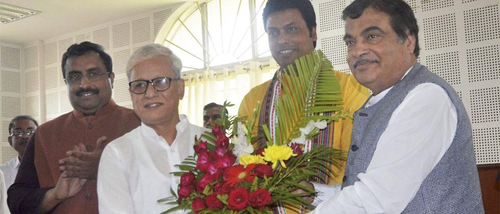 Union minister Nitin Gadkari congratulates Jishnu Devvarman after he was selected as Tripura's Deputy Chief Minister in a party meeting, in Agartala on Tuesday. Also seen is Tripura BJP President and Chief Minister-designate Biplab Deb. Photo-PTI