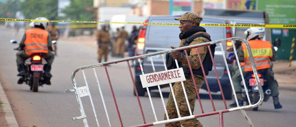 Burkina Faso police establish a barrier on August 14, 2017 in Ouagadougou, following a deadly attack by gunmen on a restaurant.