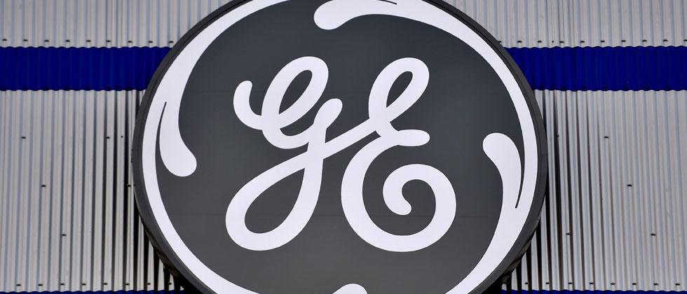 File photo taken on November 21, 2016 the logo of US company General Electric is seen at a factory of the group, in Montoir-de-Bretagne, western France. Loic Venance/AFP