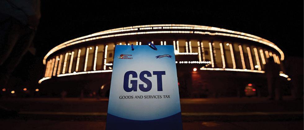 An illuminated Parliament House ahead of midinight launch of GST
